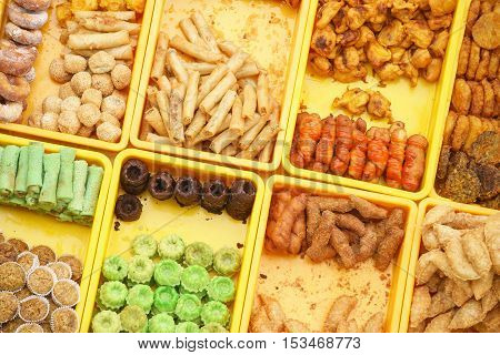 Overhead shot of variety delicious and colorful Malaysian home cooked local cakes or