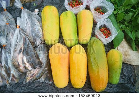 Papaya freshwater fish wrapped in plastic red chillie and vagetable sold at open market called Tamu in Sabah Malaysian Borneo.