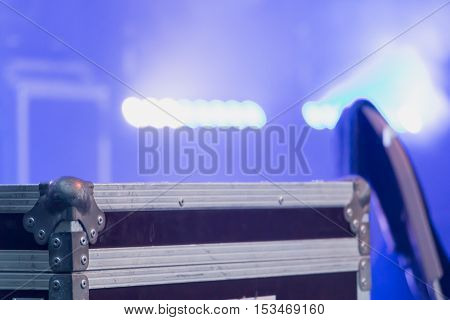 flight case on stage Lighted by light projectors on a concert