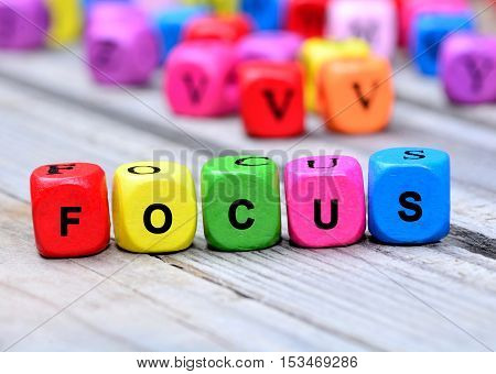 Focus word on gray wooden table closeup