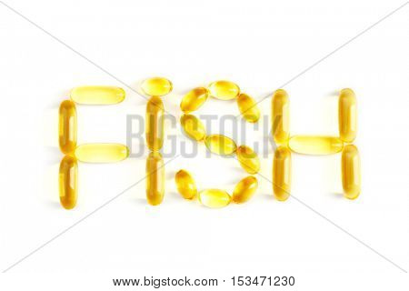 Word FISH made of cod liver oil capsules on white background