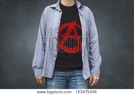 Anarchy symbol print on t-shirt political message. Selective focus.