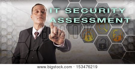 Assertive and self-assured assessor is pushing IT SECURITY ASSESSMENT onscreen. Information technology concept for corporate computer security security policy creation and risk identification.