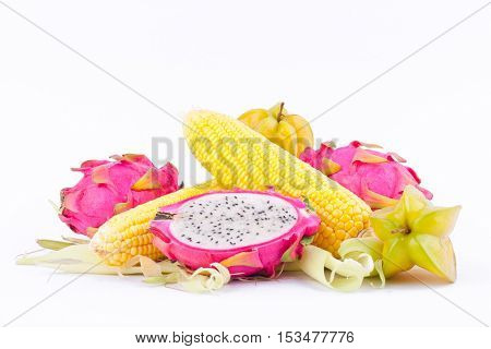 sweet corn cobs kernels and dragon fruit pitaya and star fruit carambola  on white background  fruit and vegetable isolated