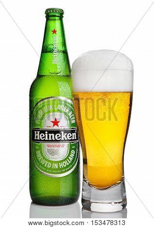 LONDONUK -OCTOBER 23 2016: Bottle of Heineken Lager Beer with glass on white background. Heineken is the flagship product of Heineken International