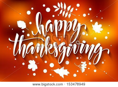 Thanksgiving greeting card with hand drawn vector calligraphic inscription and leaves on blurred autumn background. Happy Thanksgiving