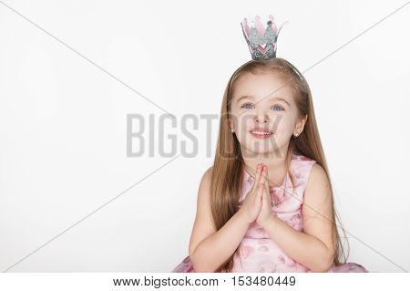 one young girl child begging looking up at viewer and hoping for something isolated on white background with copy space