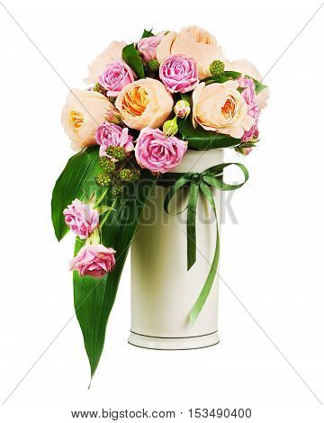 Colorful flower bouquet from roses and peon flowers in vase isolated on white background. Closeup.