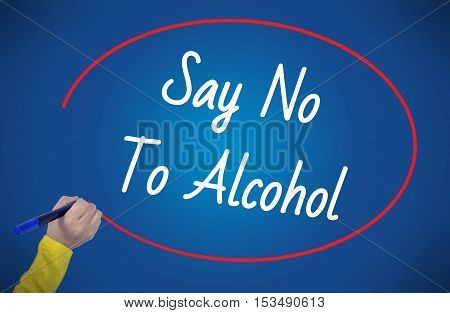 Woman's Hand writing say no to alcohol on blue background. Business technology workout internet concept young.