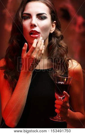 Young woman dressed as vampire for Halloween party, closeup