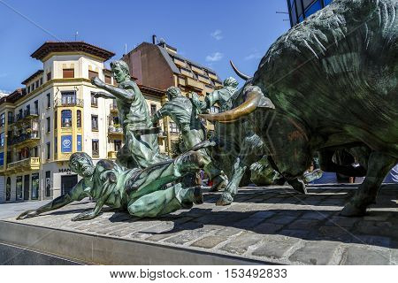 Pamplona Spain - August 21 2016: Monument of Encierro Running of the Bulls in historic part of Pamplona the monument is dedicated to the traditional festival of San Fermin. by Rafael Huerta Celaya