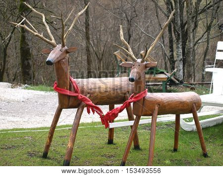 wooden deer in the park with a sleigh