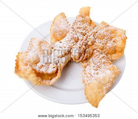 Sweet fried puff biscuits covered with sugar powder. Isolated on a white background.