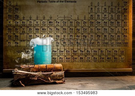 University chemical lab with color beakers on old wooden table