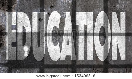 Education Written On A Wall With Jail Bars Shadow
