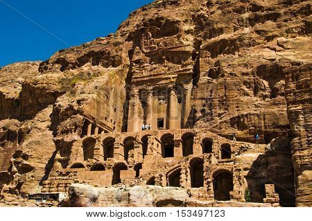 Photo of the Overall view Urn Tomb, first of famous Royal Tombs, Petra, Jordan. Touristic place. Travel and vacation concept.