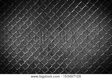 old metal fence on a dark background