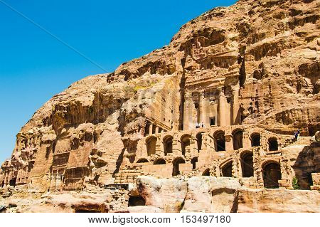 Photo of the Overall view Royal Tombs, the first one Urn Tomb, Petra, Jordan. Touristic place. Travel and vacation concept.