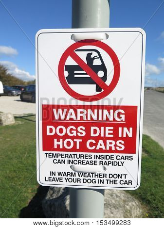 Sign in car park warning of dogs overheating in cars