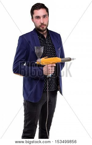 Serious young man with powder gun on white background