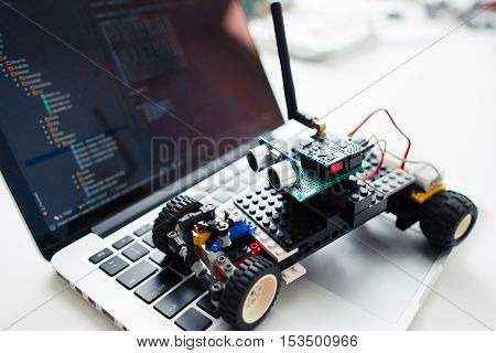 UKRAINE, KHARKIV- OCTOBER 1 , 2016. Diy rc car made on base of Arduino Pro Micro microcontroller and construction Lego Technic on laptop, close-up. Hobby, electronics, geek concept