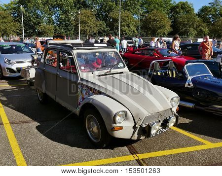 Amsterdam The Netherlands - September 10 2016: Grey Citroën Dyane oldtimer on display during Cars & Coffee XXL show. Non-ticketed public event held in the streets of the city with people carspotting.