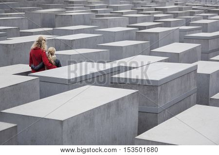berlin germany 16 october 2016: mother and daughter at holocaust monument in berlin