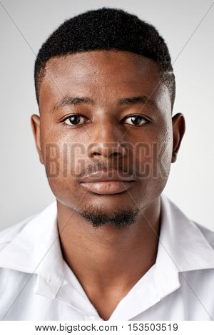 Portrait of real black african man with no expression ID or passport photo