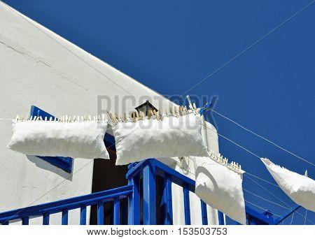 White cushion lying in a Greek house