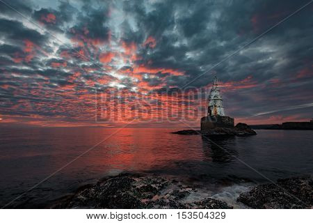 Magnificent cloudy sunrise at the Lighthouse, Ahtopol, Bulgaria