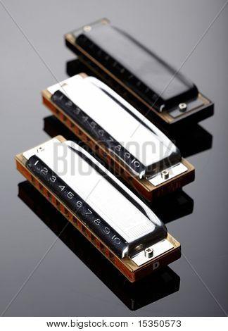 Tree harmonicas on dark background