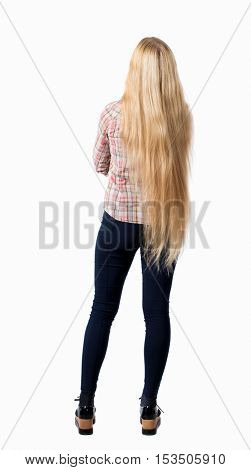 back view of standing young beautiful  woman.  girl  watching. Rear view people collection.  backside view of person.  Girl with very long hair standing with his arms crossed.