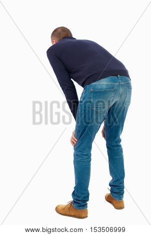 Back view of a man who rests in his hands leaning. Standing young guy. Rear view people collection.  backside view of person.  Isolated over white background.  Man in warm jacket is resting wearily.