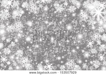 Christmas background with snowflakes stars and place for text. Sparkly holiday background with copy space. Gray and silver background
