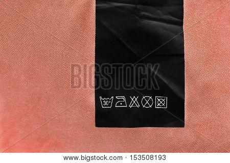 Washing instructions black label on beige background