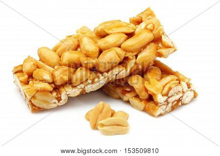 Bars with peanuts isolated close-up on white background.