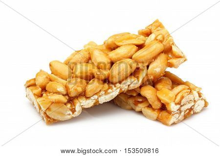 Bars with peanuts isolated on white background.