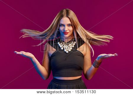 Beautiful glamourous woman with long brown flying hair, studio shot
