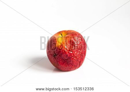 Wizen apple presented as old aging skin