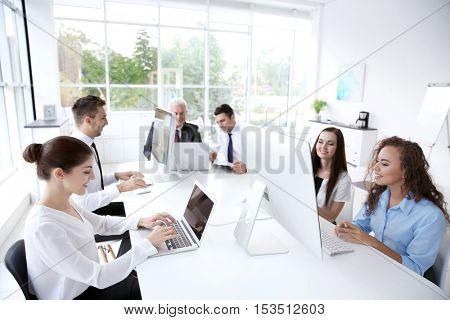 Business training concept. Colleagues working on computers at office