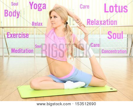 Young woman practising yoga at gym. Yoga and health care concept.