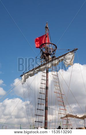 Masts of a pirate ship, cloudy sky