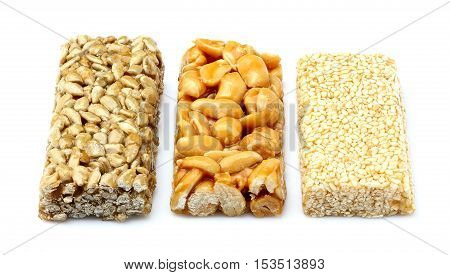 Bars with peanuts sesame and sunflower seeds isolated on white background.