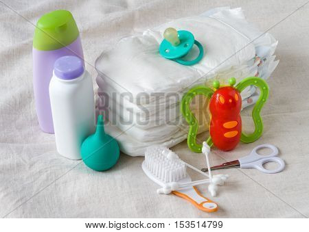 Items for newborn diapers ear sticks toy squirt cream and powder nipple pacifier