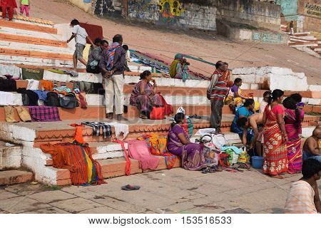 VARANASI, UTTAR PRADESH, INDIA - FEBRUARY 17, 2016 - Unidentified indian crowd sitting and talking on the ghats of Varanasi, the spiritual capital of India