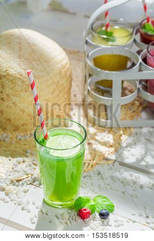 Sweet smoothie with fruity yogurt on wooden table
