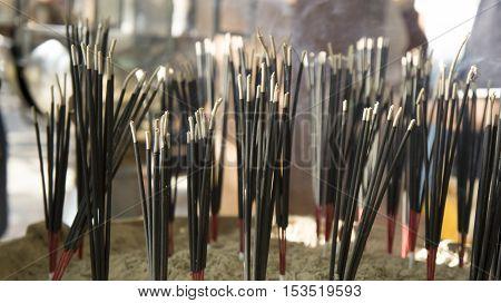 burning black incense joss stick light smoke