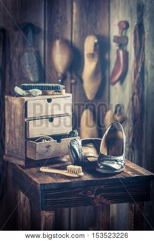 Old Shoemaker Workshop With Tools, Leather And Shoes