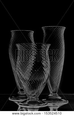 various types of crystal glasses over black background