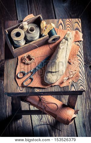 Small Cobbler Workshop With Tools, Shoes And Leather